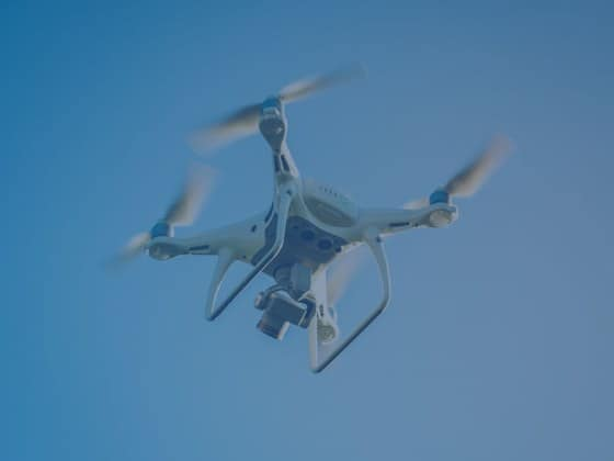 IoT project drone flying in the sky blue
